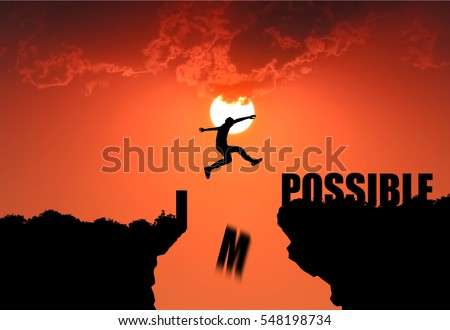 Silhouette of businessman jumping over cliff and impossible message on sunset background , business concept , I possible