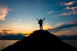 silhouette of businessman on mountain top over sunset sky background, business, success, leadership and achievement concept
