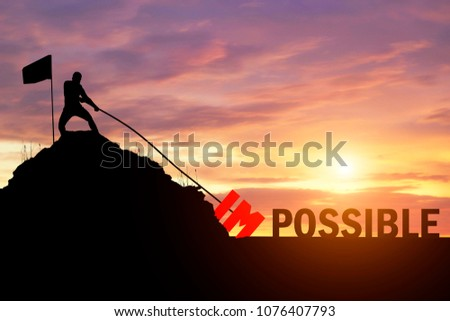 Silhouette of businessman success to eliminate, change impossible to possible text