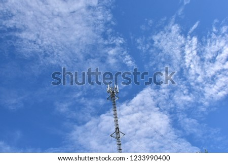 Silhouette of cellular antennas in the sky #1233990400