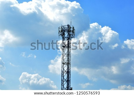 Silhouette of cellular antennas in the sky #1250576593