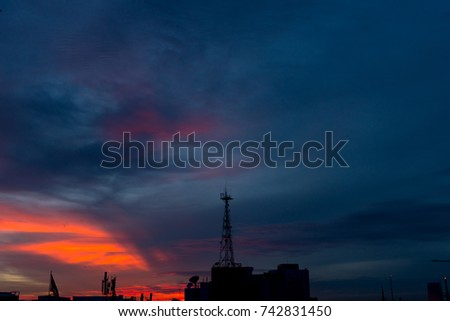 Silhouette of cellular tower with beautiful sunset cloudy sky #742831450