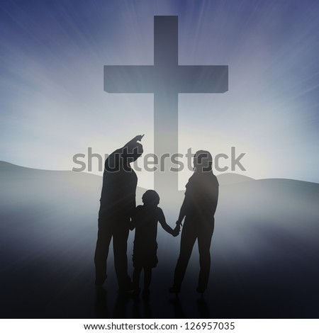 Silhouette of Christian family at the Cross on blue background