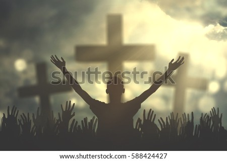 Silhouette of christian prayers raising hand while praying to the Jesus - Shutterstock ID 588424427