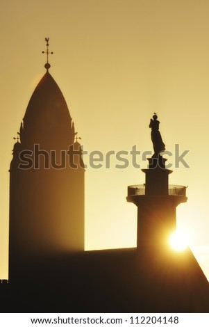 Silhouette of church at sunrise