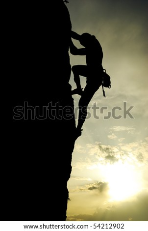 Silhouette of climber at the sunset. Element of design.