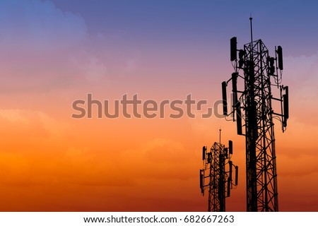 silhouette of communication tower with dusk sky with space for text