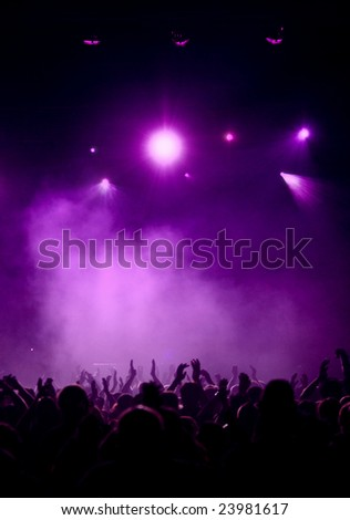 Silhouette of concert crowd, elegant violet light in the background