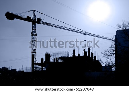 Silhouette of construction site against the blue sky