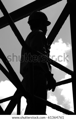 Silhouette of construction worker with hardhat