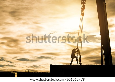 Silhouette of container crane with people working , lifestyle work