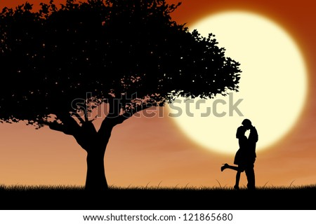 Silhouette of couple kissing near a tree on orange sunset background