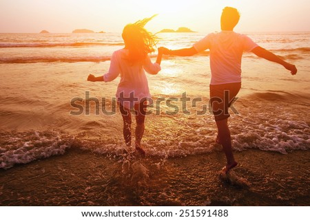 silhouette of couple on the beach, dream vacations
