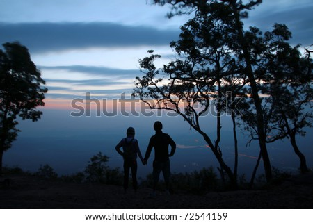 Silhouette of couple on tourists. When sunrise