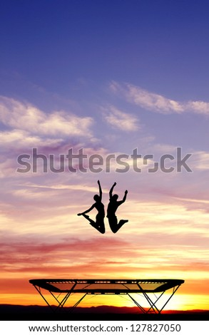 silhouette of couple on trampoline