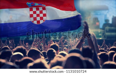 Silhouette of Croatia supporter fans cheering on soccer game #1131010724