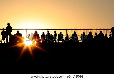 Silhouette of Crowd at Sporting Event at Sunset