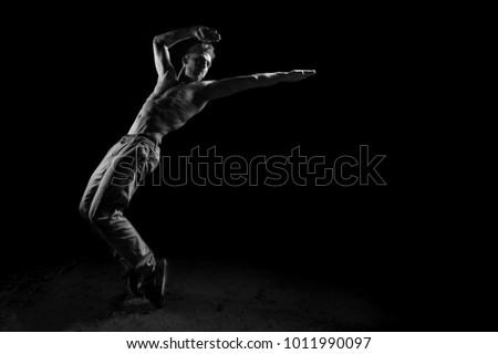 Silhouette of dancer in dancing concept #1011990097