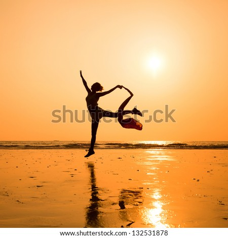 silhouette of dancing woman on the beach, inspiration