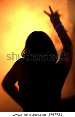silhouette of dancing woman waving her arms