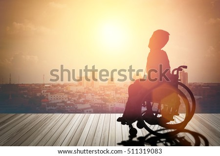 silhouette of disabled on wheelchair or background.day of the disabled person .Concept cripple or disabled .art Plant Dawn View Cloud Calm Card  Bright  Blue World model   love night sunrise alone sea