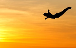 silhouette of diver in sunset