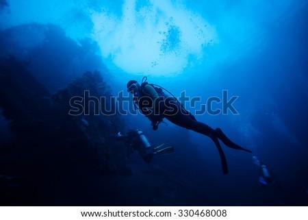 silhouette of diver underwater #330468008