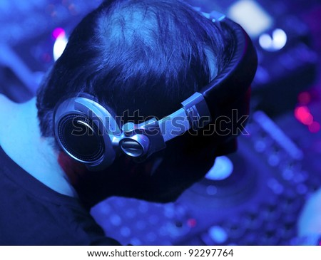 Silhouette of DJ headphones in the nightclub at a party