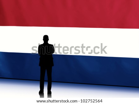 Silhouette of dutch politician with arms crossed against flag background