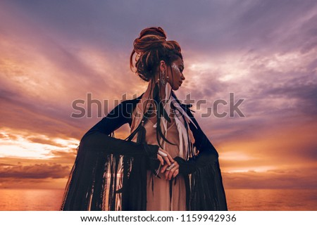 silhouette of elegant woman on the beach at sunset and  #1159942936