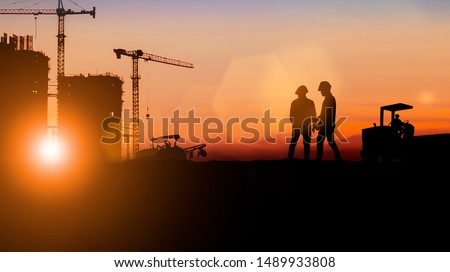 Silhouette of engineer and construction team working at site over blurred background for industry background with Light fair For industrial businesses, global contract work #1489933808