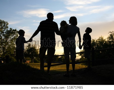 silhouette of family together outdoors