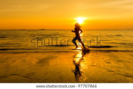 silhouette of female runner during sunset - stock photo