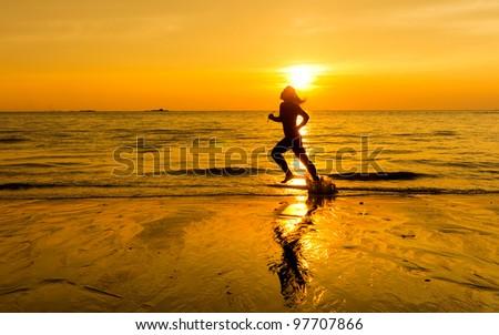 silhouette of female runner during sunset