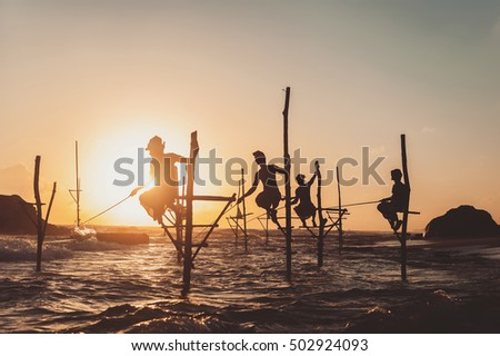 silhouette of fisherman on...