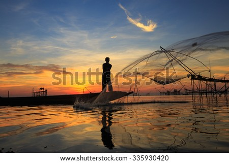 Silhouette of fishermen at talay noi, Pattalung Province, South of Thailand #335930420