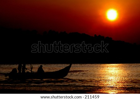 silhouette of fishermen at work during dawn