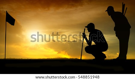 silhouette of golfers hit sweeping and keep golf course in the summer for relax time #548851948