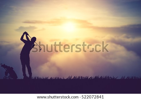 silhouette of golfers hit sweeping and keep golf course in the summer for relax time.Vintage color