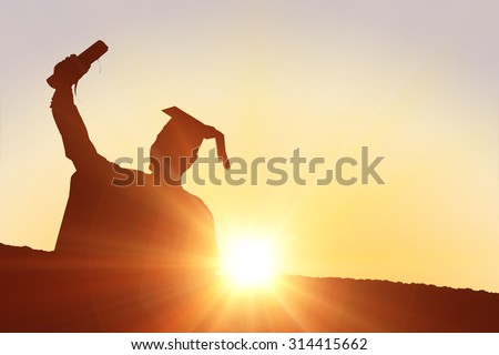 Silhouette of graduate against sun shining #314415662