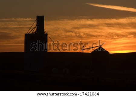 Silhouette of Grain Elevator out on the Prairie at Dusk