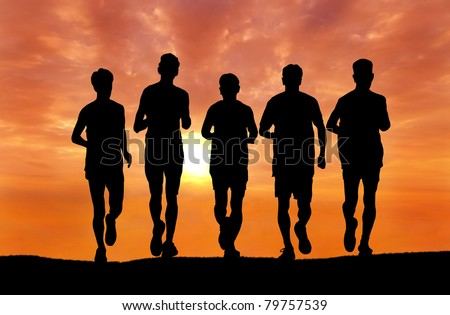 silhouette of group of man running at sunset