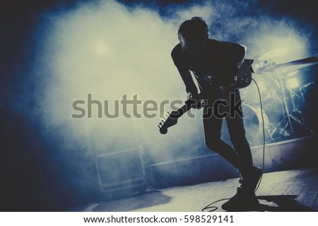 silhouette of guitar player  ...