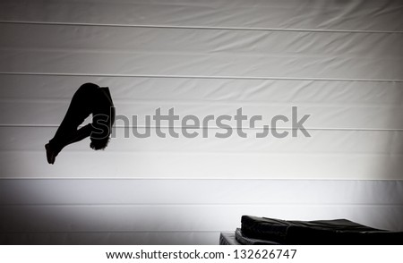 Royalty Free Somersault Silhouette On Trampoline 56756632