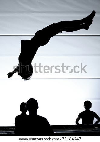 silhouette of gymnast on trampoline
