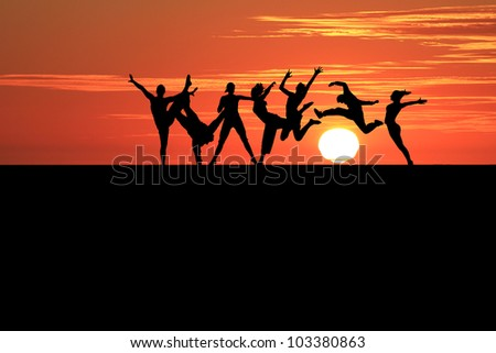 silhouette of gymnasts in sunset