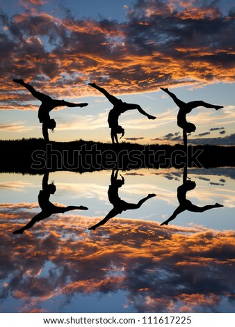 silhouette of gymnasts in sunset at beach
