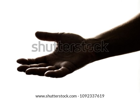 Silhouette of hand reaching out to give, or to receive help/money/hope/gift. #1092337619