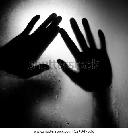 silhouette of hand with glass black and white