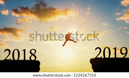 Silhouette of happy man on beautiful view. Freedom or victory concept of Happy New year 2019.  #1224267316